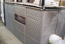 Noise Control enclosure comprised of a metal frame, Velcro and two inch thick lightweight acoustical fiberglass quilt absorber.